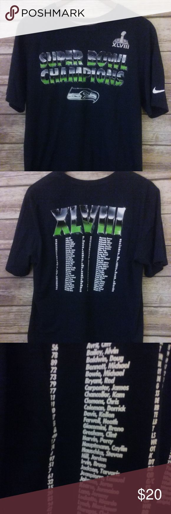 """Seahawks SuperBowl Champions XLVIII T-shirt Size L Unique Nike Men's Seattle Seahawks Super Bowl Champions XLVIII T-shirt Size Large Regular Fit, has Super Bowl Champions on front, the team roster on back and Nike logo on one sleeve.  Measures approximately:  28"""" long from back collar 20"""" underarm to underarm  Please measure against current items in your closet :) Nike Shirts Tees - Short Sleeve"""