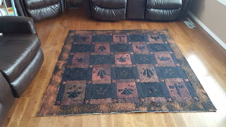 This is a quilt that I designed using the bleach method of removing the dye from black fabric.