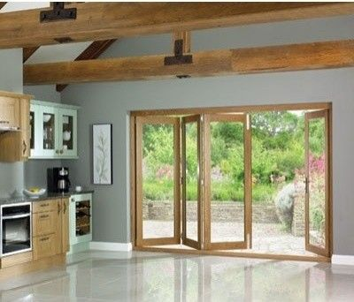 La Porte Vista Oak Folding Patio Doors, Fully Decorated