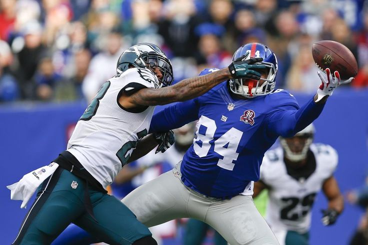 Philadelphia Eagles' Nolan Carroll, left, defends against New York Giants' Larry Donnell (84) during the first half of an NFL football game Sunday, Dec. 28, 2014, in East Rutherford, N.J. (AP Photo/Kathy Willens)