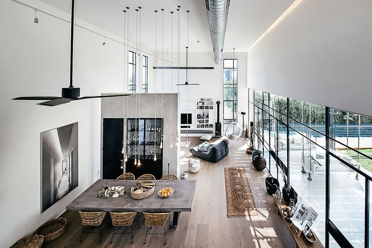 Connected by a 13-foot passage, the Savion House keeps private and public areas completely separate. The front cube contains a communal living room, kitchen, dining room, and a second-story study, with wide plank and concrete floors running throughout. The space...