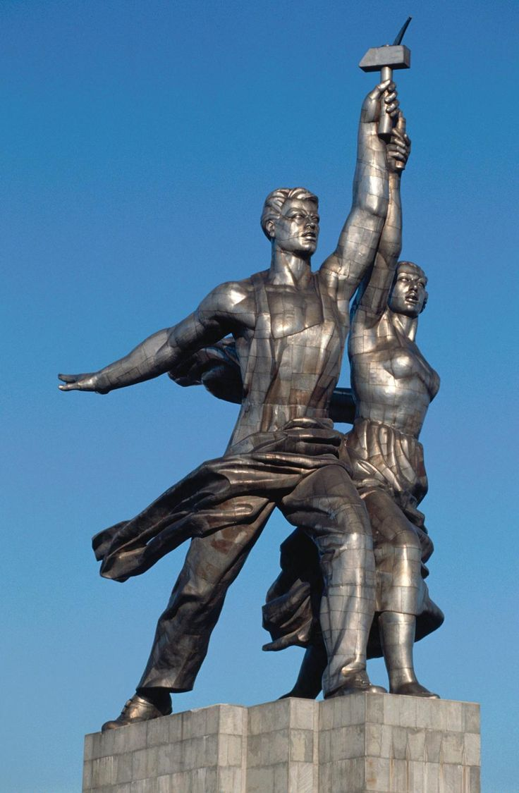 """Worker and Kolkhoz Woman. (Russian: Рабо́чий и колхо́зница Rabochiy i Kolkhoznitsa) is a famous landmark of monumental art, """"the ideal and symbol of the Soviet epoch"""", that represents a dynamic sculpture group of two figures with a sickle and a hammer raised over their heads. It is 24.5 meters (78 feet) high, made from stainless steel by Vera Mukhina for the 1937 World's Fair in Paris."""