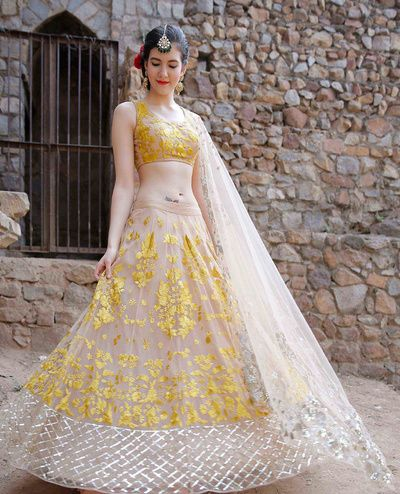Ash and Yellow Lehenga by Astha Narang , twirling bride , sleeveless blouse , yellow mehendi lehenga , threadwork lehenga , spring summer , sister of the bride outfit