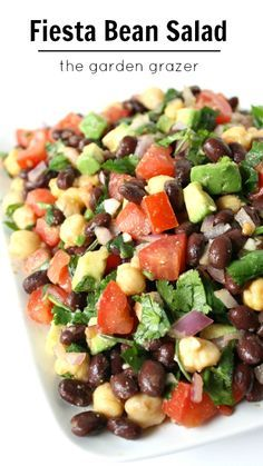 Love these southwestern flavors!! Fiesta Bean Salad with cumin-lime dressing. Perfect for take-along lunches and picnics too! | thegardengrazer.com | #vegan #gf
