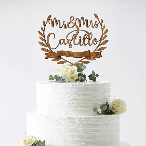 Order your personalized cake topper with custom calligraphy. We laser cut and hand craft them in light and dark woods, mirror silver, glitter silver, glitter gold, and classic black Available on Etsy at http://etsy.me/2nu0kZC