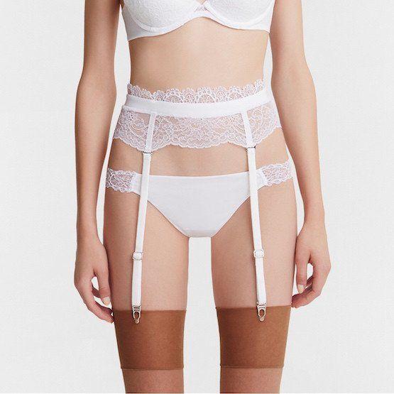 Blonde strip white suspender belts