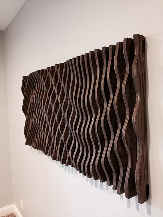 This parametric wall wave is a visually intriguing piece of wall art. Comprised of 47 individually cut pieces of 3/4 cabinet grade oak plywood that spaces apart to displays a sweeping and organic parabolic wave. This piece is 58 long, 28 wide, and 3 thick at its thickest. It requires assembly but is simple to do with the supplied wall brackets and screws. Let this piece be the conversation piece in your home or office