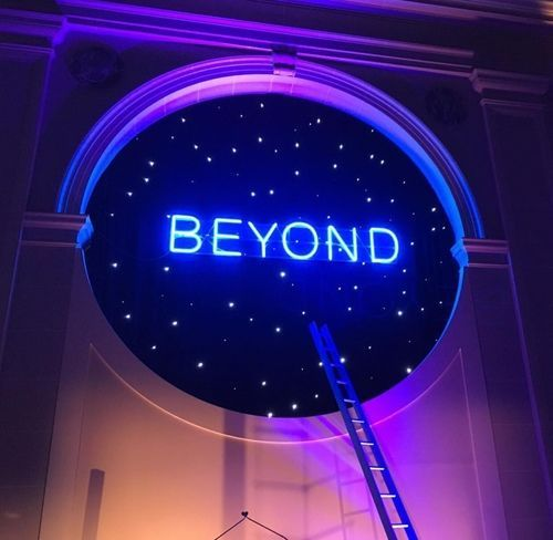 BEYOND neon light up outer space circle sign typography galaxy stars spacey lights