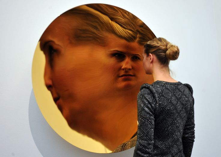 Anish Kapoor, 2009. Reflection of a visitor in one of Kapoor's highly reflective disc sculptures.
