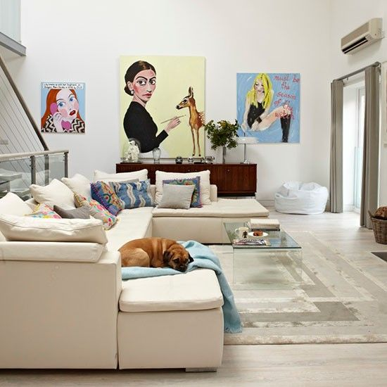 Living area with statement artwork and cushions