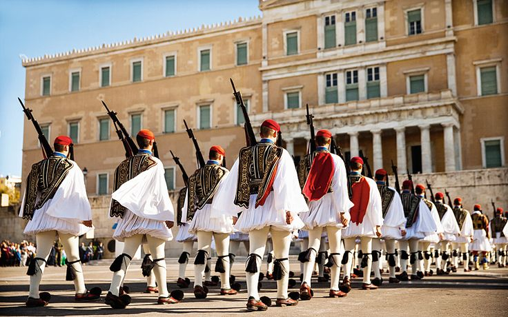 These men are called Evzones and are part of the Presidential Guard. They guard the Greek Tomb of the Unknown Soldier in Athens.