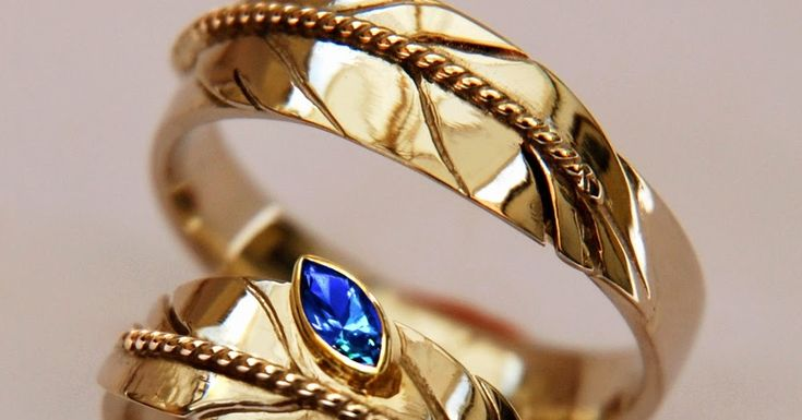 Mino-inaadiziwin (A Good, Upright Life). Two-tone gold eagle feather rings, the ladies' ring featuring a marquise-cut sapphire. Design and title of the rings are inspired on an old Midewiwin invocation of the spirit-grandfathers of Giiwedin, the North. Minode-izhiwishinaang ji-mino-inaadiziwinaangen. ( Fill our hearts with Goodness so that ww may live upright lives). #ojibweweddingrings  #Midewiwin  #Ojibwe  #Anishinaabe  #Mino-bimaadiziwin  #bimaadiziwin
