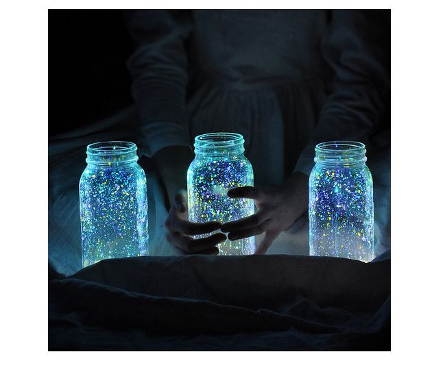 I'm in love with this idea… and such a cool alternative to patio lights.  All you have to do is gather a few mason jars, flick some glow-in-the-dark paint in the jars, and let them sit in the sun to charge during the day. By the time your dinner party rolls around you'll have firefly lanterns.