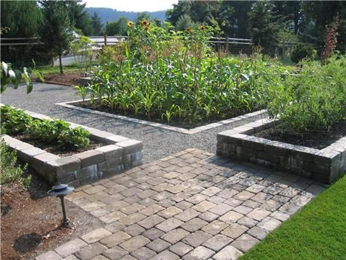 Use pavers to outline raised beds!!! Looks really classy!