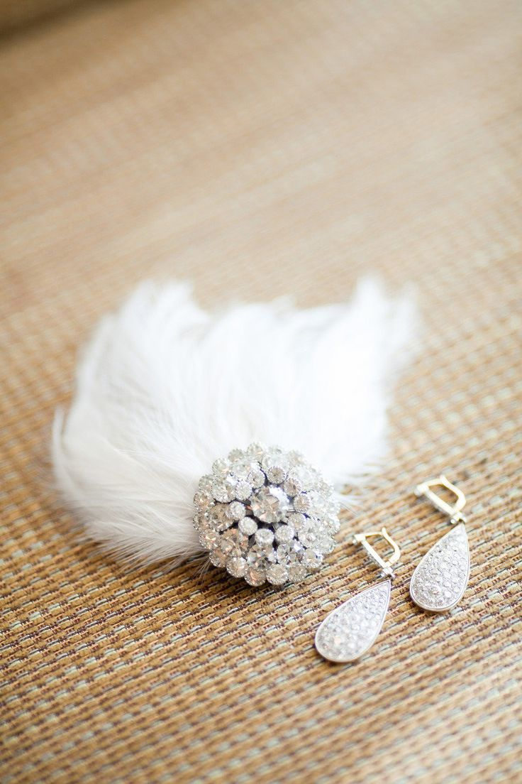 #brooch, #feathers  Photography: Caroline Tran - carolinetran.net Event Design + Planning: Amber Events - amberevents.com Floral Design: Butterfly Floral & Event Design - butterflyfloraldesign.com  Read More: http://www.stylemepretty.com/2012/05/30/los-angeles-wedding-reception-by-amber-events-caroline-tran/