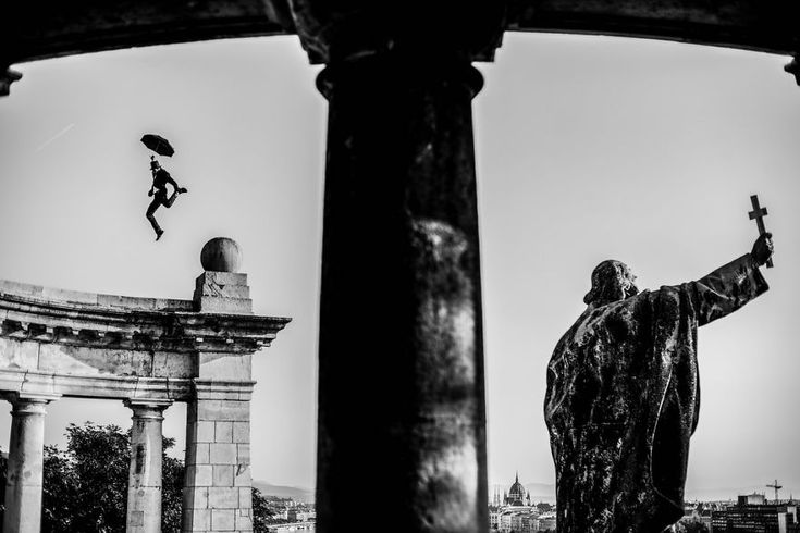 I Captured A Mysterious Umbrella Man Balancing On Budapest's Famous Sights   Bored Panda