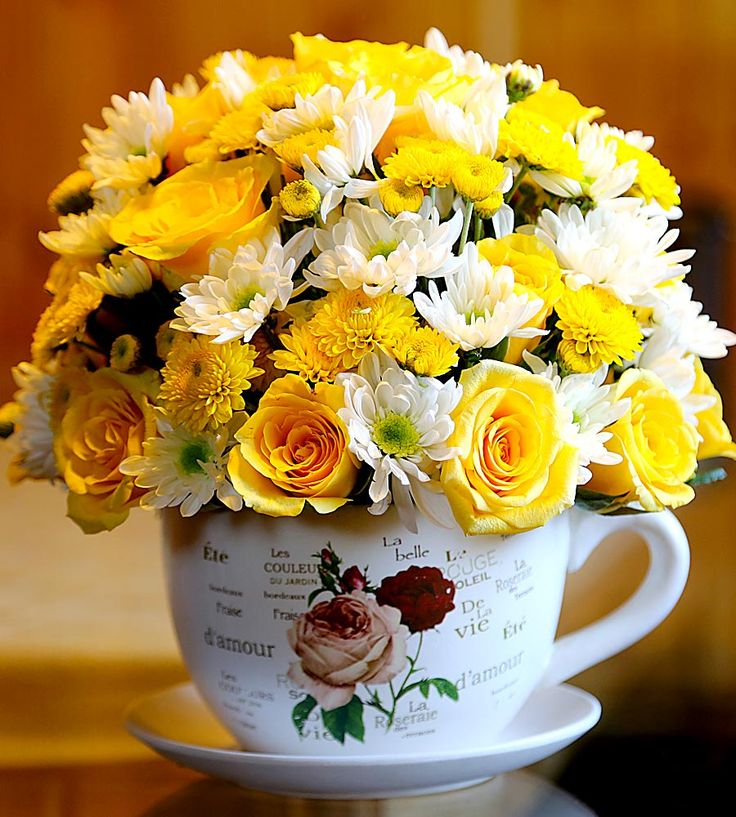 Serve With Love! This Cup & Plate Bouquet is a perfect blend of yummy and exotic flowers, best to brighten up this Valentine Day.