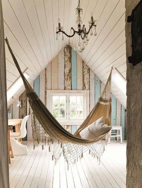 Indoor hammock, whitewashed floorboards / floors, chandelier, driftwood detailing, high ceilings / via A Beach Cottage