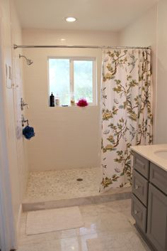 Walk-in standing shower with shower curtain instead of glass door or wall.