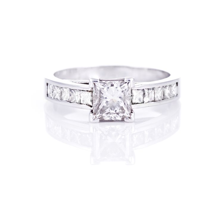 Princess Cut Centre with channel set side stones set in 18 ct White Gold