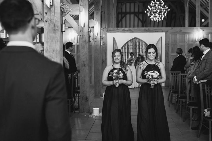Here comes the bride! @RivervaleBarn Photo by Benjamin Stuart Photography #weddingphotography #bridesmaids #herecomesthebride #blackandwhite #rivervalebarn