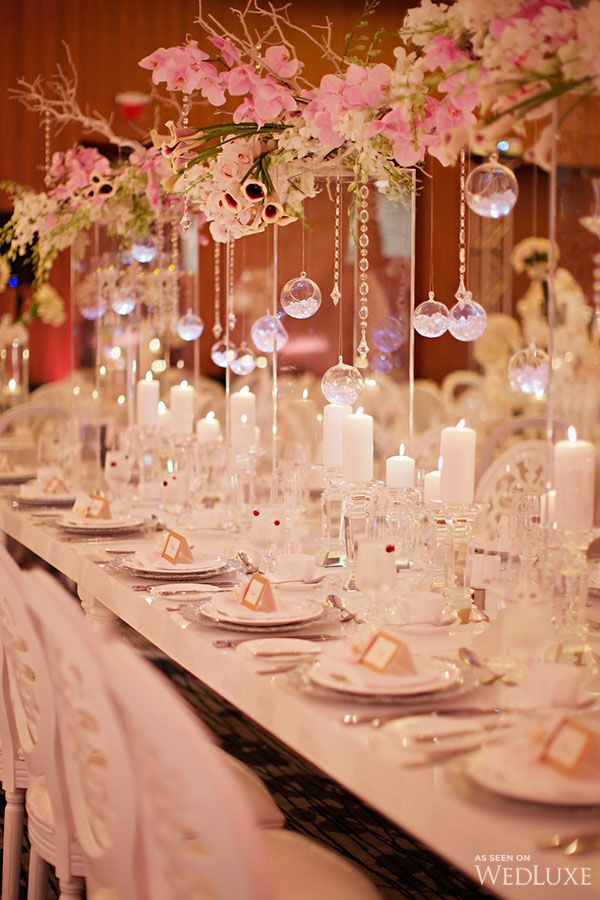 A Modern Fairytale Wedding From Our Current Issue |We think you'll be totally captivated by the dreamy floral displays, especially the bride's cascading bouquet and the canopy decorated with hundreds of crystals and pink rose buds that guest walked through as they entered the ballroom| Photography by: Jonetsu Studios