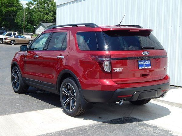 2014 Ford Explorer Sport 4X4 in Ruby Red Metallic and two-tone Charcoal/Sienna perforated leather trimmed seats. Definitely not your ordinary Ford Explorer. #fordexplorer