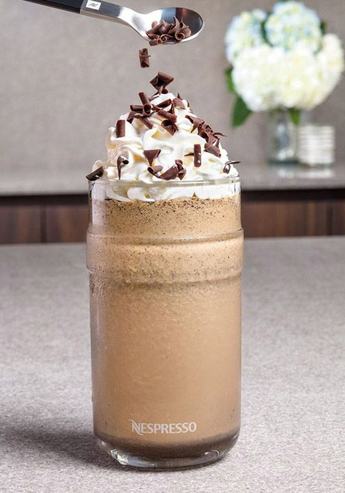 To make this delicious iced coffee creation, brew two capsules of richly flavored Dharkan Grand Cru and pour it into a VertuoLine Recipe Set glass. Then add a blended mixture of cookie crumbs, vanilla ice cream, and chocolate syrup to the espresso. This indulgent dessert beverage is sure to satisfy your sweet tooth!