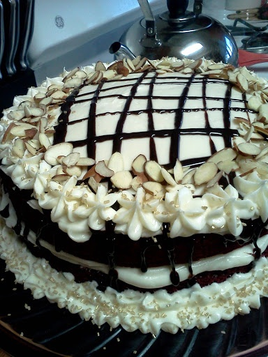 """Red Velvet Cake! 2.60 stars, 6 reviews. """"Easy and delicious recipe! I added 2 tbls mayo and half a pkg of chocolate pudding dry mix to make extra moist! Frosted with cream cheese frosting and chocolate stripes. Also added sliced almonds for extra texture. So yummy!"""" @allthecooks #recipe #thanksgiving"""
