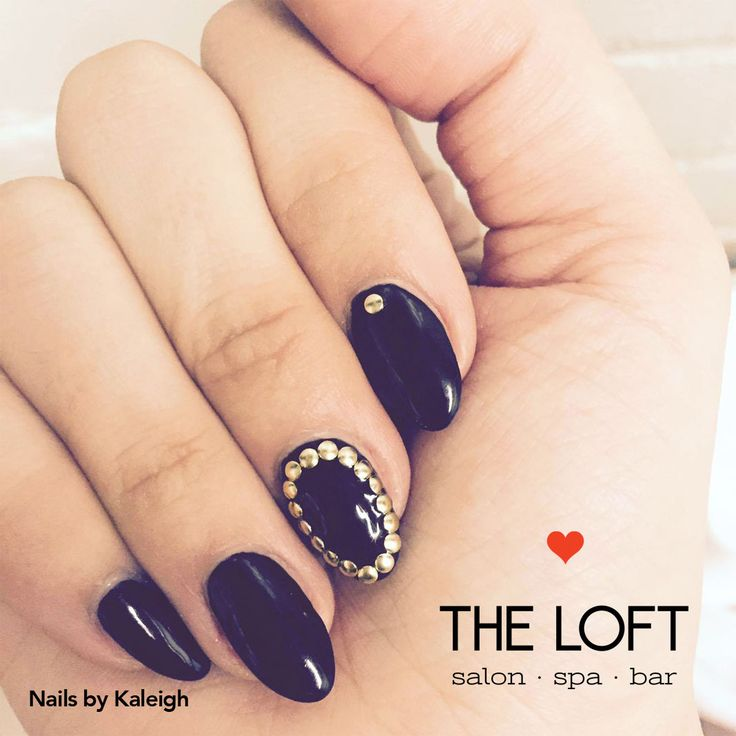 Black manicure with gold studs by Kaleigh at The Loft in Winnipeg.