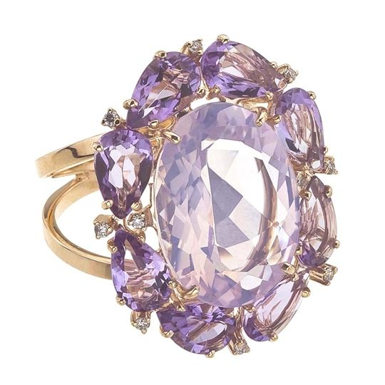 VIANNA 18K Rose Gold Amethyst 'Madame' Ring. You can practically smell the sweet scent of lilac when you wear this Amethyst cocktail ring from Brazilian designer Vianna's Madame collection, featuring a light purple, lilac-hued Amethyst surrounded by deeper, darker purple Amethysts set in rich rose Gold. The country's native gemstones command center stage in this collection, and the precious rose Gold gives a touch of old-fashioned romance to this statement piece. $1,950.00