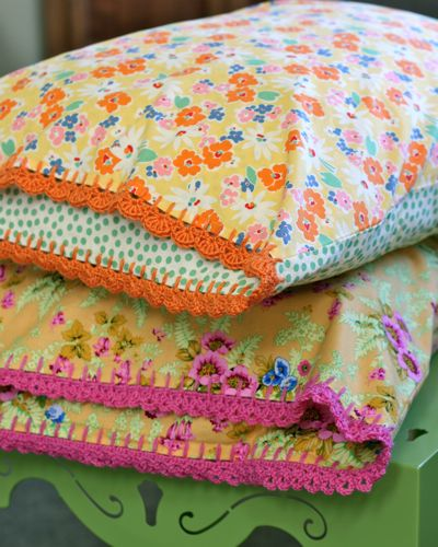 Nice site with pillowcase tutorial and also tutorial teaching how to crochet the edging shown here.