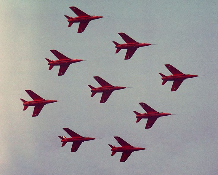 https://flic.kr/p/hnWWjT | Swarming Gnats | The Royal Air Force Aerobatic Team - The Red Arrows with their Folland Gnat T.1's displaying at the Bassingbourn Air Show on the 27th May 1978. For the record the leader was flying XS101 with XR977, XR991, XR572, XR540 in the box, XR535, XS107, XP514 and at the rear XR955. Scanned and recovered from a grim 35mm transparency