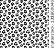Animal footprint seamless pattern. by bekulnis, via Shutterstock