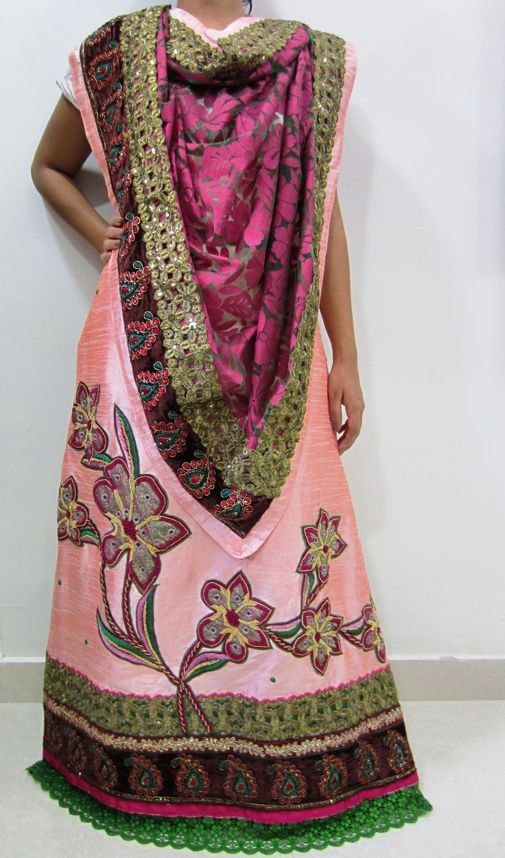Description - Lustrous light coral colored jodi designed using cut-work, dori work and guipure laces enhanced with beautiful zardozi work flower appliques on lehenga. Rich maroon colored brasso dupatta completes the look of this occasional / wedding wear ensemble.