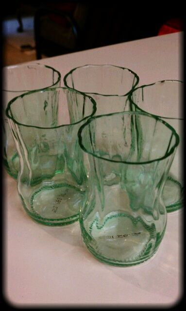 These are made from empty glass soda bottles. I've been keeping the ones we have gotten lately and this is a great idea to make a set of glasses from them.