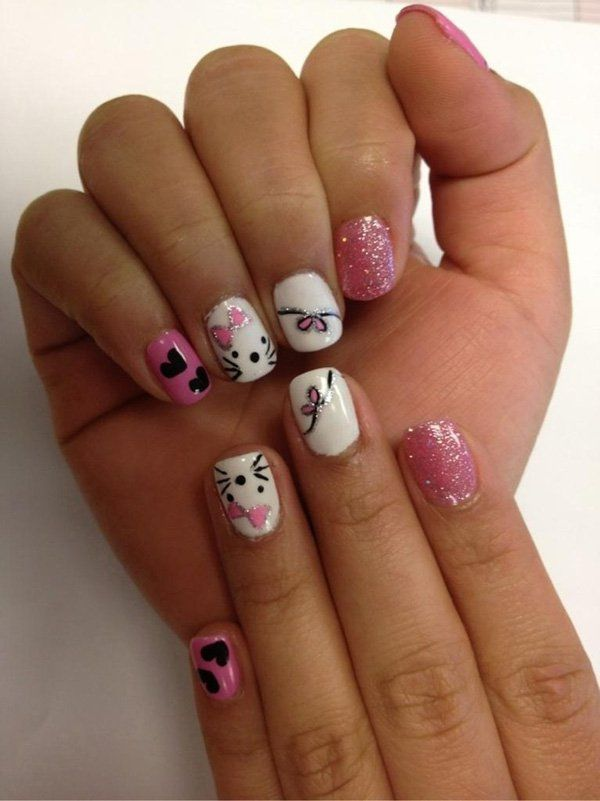 Be posh in pink and white! Matted in white and pink, the nails are then detailed with lines, pink bows, little black hearts and Hello Kitty faces and pink bows. Cute and very adorable, there is also an occasional dab of pink glitter nails so that the look is complete.