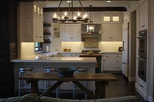 Custom kitchen with built-in appliances, quaint island, drawer and utensil organizers, a dual trash pull out, a lower cabinet spice pull out, inside cabinet and under counter lighting, and more.  See more... https://www.prestigemouldings.net/farmhouse-suburban