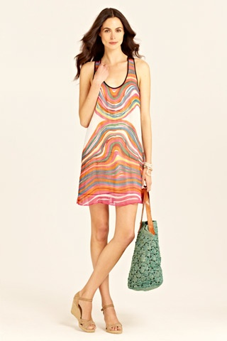 the definition of versatility - this candy land reversible print dress transforms