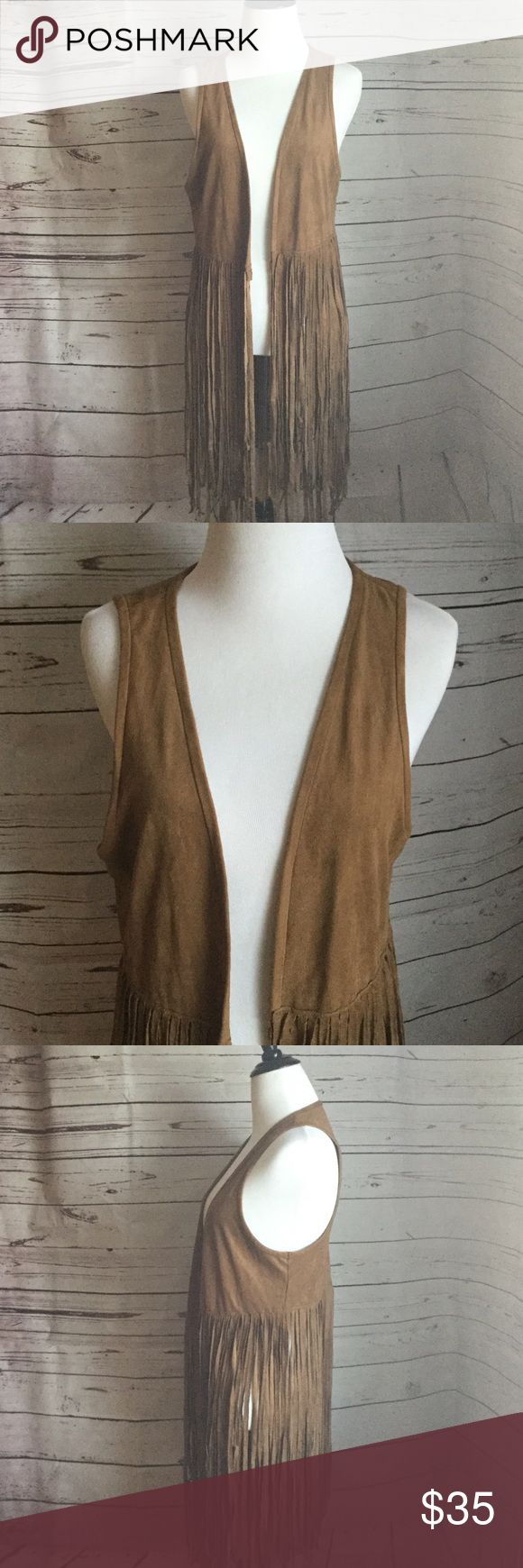 "Abercrombie and Fitch Faux Suede Vest Size M Abercrombie & Fitch long fringe faux suede vest, Size M. Very trendy. Perfect for music festivals and high waisted shorts. Vest has fringe detailing that comes down. Please refer to length measurements since fit varies on height. Item is preowned very light signs of wear. In great condition. Reasonable offers welcomed.  Measurements approx: 34"" from neck to fringe, 21"" armpit to armpit, 16"" vest part only. Please feel free to ask questions. ✌🏻…"