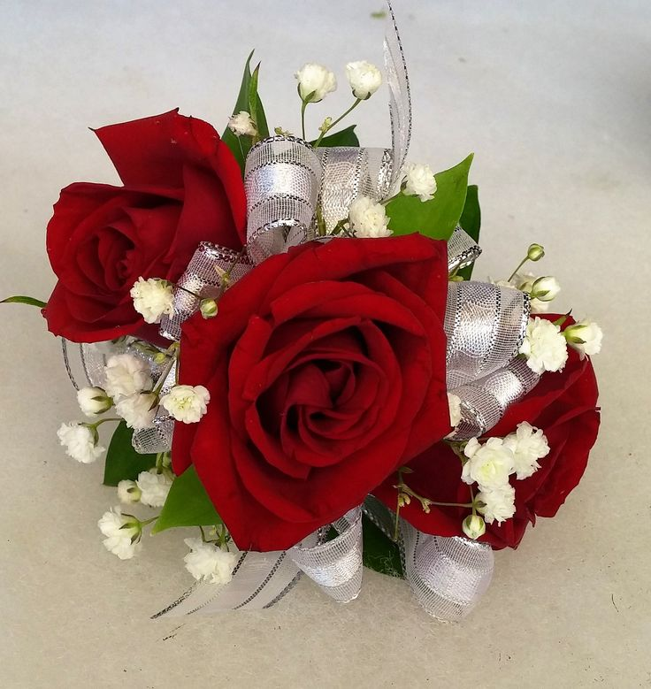 Red rose wrist corsage with babies breath and silver ribbon.  On a pearl corsage bracelet. Perfect for homecoming or prom. #WeDeliverTheWow