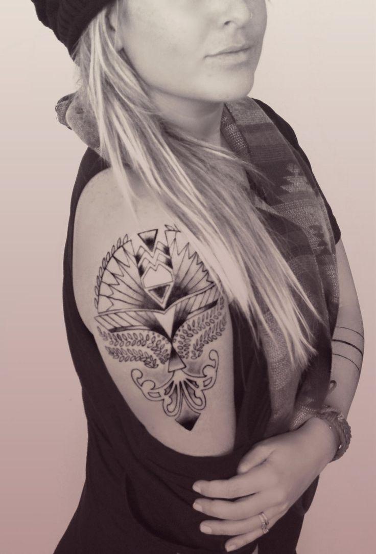 female tribal shoulder tattoo