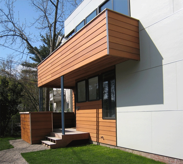 Exterior: Combination Of Cement Siding And Wood Planks.