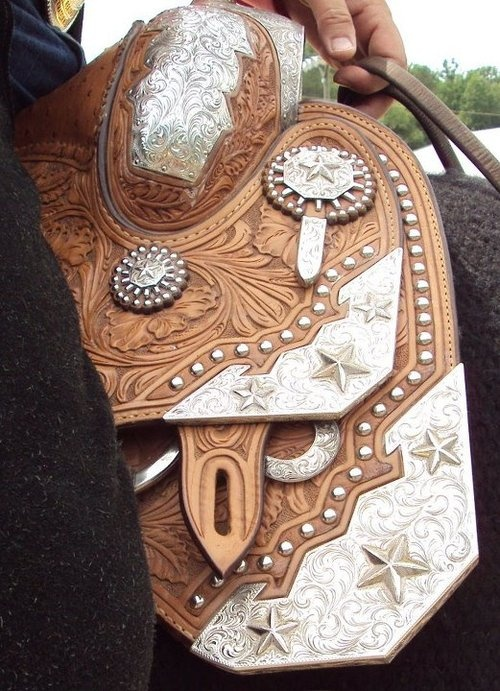 Geometric Light oil show saddle with copper inlay and silver plating.