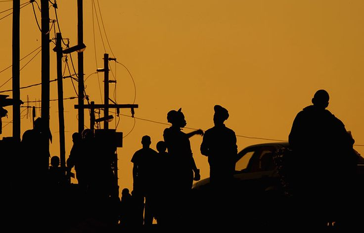 Credit: Christopher Furlong/Getty Images Residents of Diepsloot go about their daily activities as the sun sets