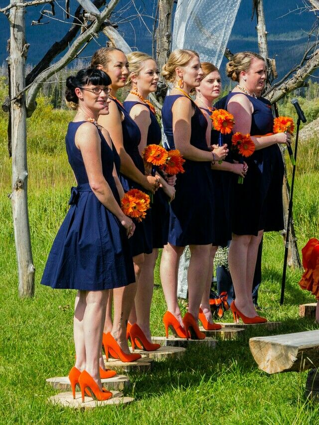 Orange and blue Broncos wedding,  simple fit and flare Audrey Hepburn style, figure flattering bridesmaids dresses, photography,  pictures, gerbera daisy bouquets