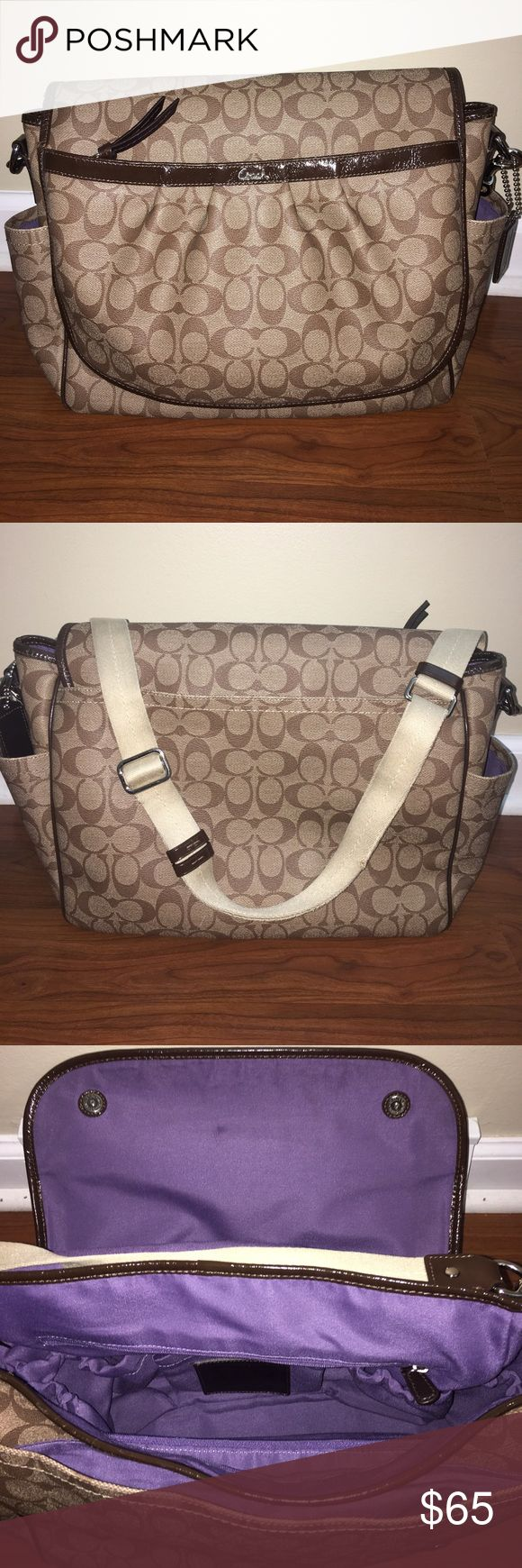 COACH SNAPHEAD BABY DIAPER BAG BROWN STYLE #F18373 In good condition with signs of wear/ tear on bottom of corners, trim on bag and a little scratch on the back of the bag as seen in pictures. Color-brown/purple, monogrammed pattern, Long strap adjustable/detachable with stitching that came apart as seen in picture. Multifunctional /very roomy. Coated canvas with patent leather trim. Inside zip, cell phone and multifunction pockets. Outside pockets (front/back), No stains inside of bag just…
