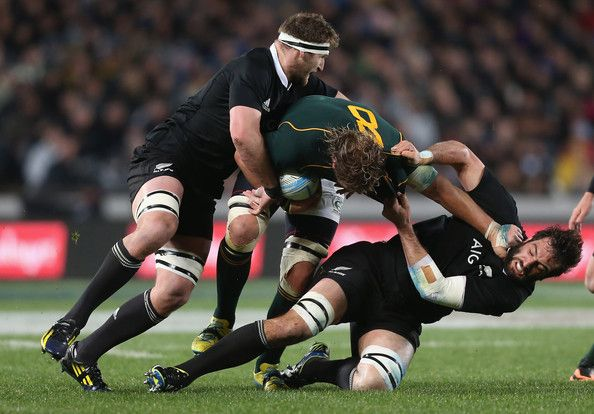 Kieran Read and Sam Whitelock Photos Photos - Kieran Read (L) and Sam Whitelock (R) of the All Blacks tackle Duane Vermeulen of South Africa during The Rugby Championship match between the New Zealand All Blacks and the South African Springboks at Eden Park on September 14, 2013 in Auckland, New Zealand. - New Zealand v South Africa - The Rugby Championship