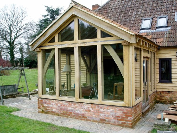 Single storey green oak frame living room extension for Outdoor room extensions