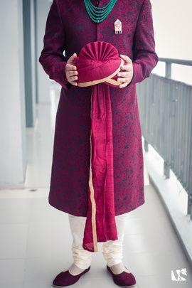 Groom Wear - Hot Pink and Dark Blue Sherwani | WedMeGood Purple and Dark Blue Sherwani with Emerald Necklace and Red Safa #wedmegood #safa #groom #wear